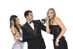 Elegants Freunde an einer Party des neuen Jahres Stockfoto