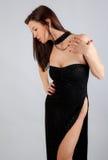 elegantt kvinnabarn för svart klänning Royaltyfri Fotografi