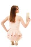eleganza Indietro della ragazza in vestito rosa e con la borsa Immagine Stock Libera da Diritti