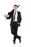 Eleganzmann, der mit einem Regenschirm aufwirft Stockbild