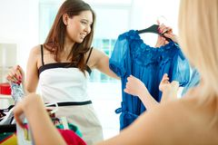 Elegir el vestido Imagen de archivo libre de regalías