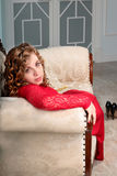 Elegnt beautiful young woman in red dress in classic interior looking in camera Stock Photos