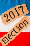 Eleição 2017, inscrição na folha de papel rasgada Imagens de Stock