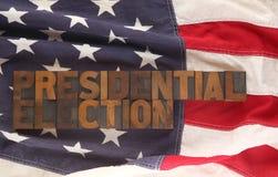 A eleição presidencial das palavras em uma bandeira dos EUA Imagem de Stock Royalty Free