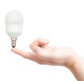 Elektriciteit die gloeilamp bewaart royalty-vrije stock afbeelding