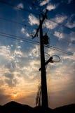Elektriciteitspylonen bij dageraad Royalty-vrije Stock Foto's