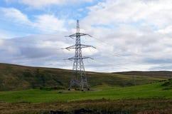Elektricitetspylon i skotsk skönhetfläck: Beauly till Denny makt Royaltyfri Bild
