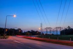 Elektricitetspyloner och solnedgång Royaltyfri Fotografi