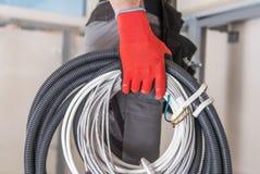 Elektriker med kablar royaltyfri foto
