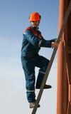 Elektrisch oben auf der Strichleiter Stockfoto