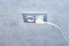 Elektrisch schließen Sie eine Sockelnahaufnahme an Kleiner flacher dof lizenzfreie stockfotografie