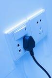 Elektrische contactdoos op de muur Stock Foto's