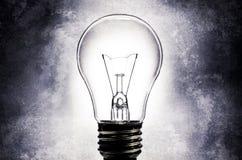Elektrische gloeilamp met lichte geweven achtergrond Stock Fotografie