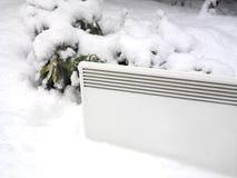 Elektrische Heater In Snow Lizenzfreie Stockfotos