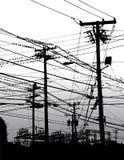 Elektrische Leitungen im Himmel Stockfotografie