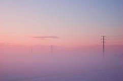 Elektrische Pole des Winters Stockfoto