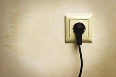 Elektrische stop in een contactdoos Stock Foto's