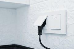 Elektrische stop in een contactdoos Stock Afbeelding