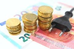 Elektrische stop met geld en muntstukken Royalty-vrije Stock Afbeeldingen