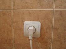 Elektrischer Anschluss mit dem Seilzug eingesteckt Stockbilder
