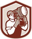 Elektrischer Beleuchtungs-Techniker Carry Spotlight Shield Lizenzfreie Stockbilder