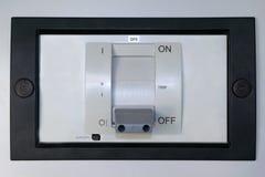 Elektrischer Leistungsschalter auf dem Vorderteil des elektrischen Kabinetts Stockfoto