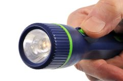 Elektrisk lampa som rymms i hand arkivfoto