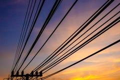 Elektrisk pol med solnedgång Arkivbild