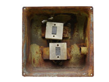 Elektrisk strömbrytare två i den rostiga metallasken som isoleras på vit Fotografering för Bildbyråer