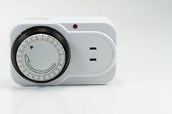 Elektrisk tidmätare på vit bakgrund Fotografering för Bildbyråer
