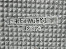 Elektriska nätverk som text på tappningmanholen Fotografering för Bildbyråer
