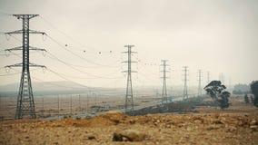 Elektriska poler i öknen Royaltyfri Foto