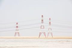 Elektriska poler i öknen Royaltyfria Foton