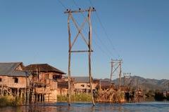 Elektriska poler på sjön Arkivbild
