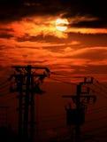 Elektriska poler på solnedgång Royaltyfria Bilder