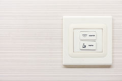 Elektriska strömbrytareknappar på väggen Royaltyfri Bild