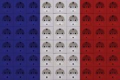 Elektriska uttag i färgerna av den franska flaggan royaltyfri bild