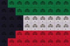 Elektriska uttag i färgerna av flaggan av Kuwait royaltyfri fotografi