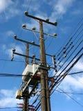 Elektrizität und Telefonseilzüge Lizenzfreies Stockfoto