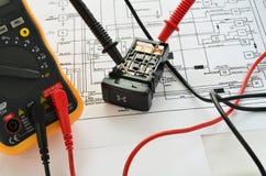 Elektro schakelaar en multimeter Stock Fotografie
