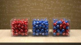 Elektron-, proton- och neutronask framme av fysikbrädet Arkivbilder