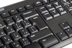 Elektroniczna kolekcja - czarna komputerowa klawiatura z kluczem wchodzić do Zdjęcia Stock