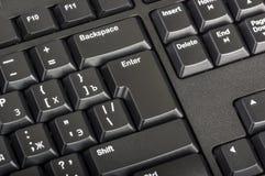 Elektroniczna kolekcja - czarna komputerowa klawiatura z kluczem wchodzić do Zdjęcia Royalty Free