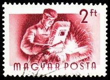 Elektroniczny spawacz, Węgierski pracownika seria około 1955, obrazy stock