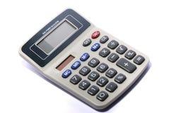 Elektronische calculator tegen een witte achtergrond Stock Foto's