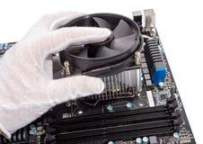 Elektronische inzameling die - cpu-koeler installeren Stock Foto