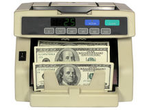 Elektronische muntteller met dollars Royalty-vrije Stock Foto's