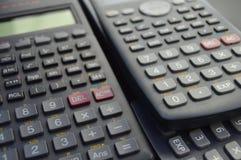 elektronische wetenschappelijke calculatorsachtergronden Stock Foto