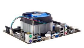 Elektronisk samling - datormoderkort med CPU-kylare Arkivfoto