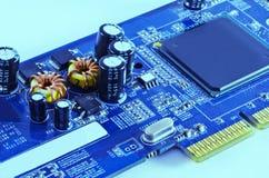 Elektronisk spole och CPU Arkivfoton
